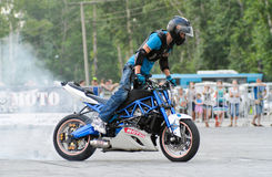 Stunt rider on a sport bike ,on a stunt battle Royalty Free Stock Photo