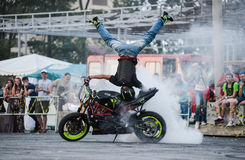 Stunt rider on a sport bike ,on a stunt battle. Khabarovsk Russia - July 11, 2015 : a  stunt rider on a sport bike ,on a stunt battle,  July 11, 2015 in Royalty Free Stock Photography