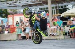 Stunt rider on a sport bike ,on a stunt battle Royalty Free Stock Image