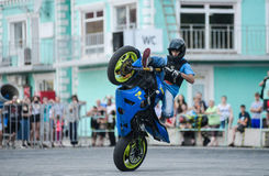 Stunt rider on a sport bike ,on a stunt battle Stock Photography