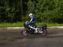 Stunt riding. On a motorcycle with the big speed Royalty Free Stock Images