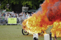 Stuntman on fire. Whilst riding a motorbike Stock Image