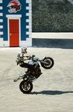 Stuntman performs a trick on motorcycle at an amusement park. RIMINI, ITALY, JULY 28,2014 Stuntman performs a trick on motorcycle at an amusement park ` Royalty Free Stock Photo