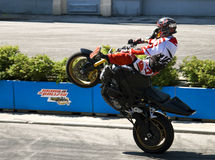 Stuntman performs a trick on motorcycle. RIMINI, ITALY, JULY 28,2014 Stuntman performs a trick on motorcycle at an amusement park Mirabilandia Stock Photography