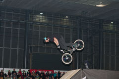 Stuntman riding a bike during stunt show Stock Images