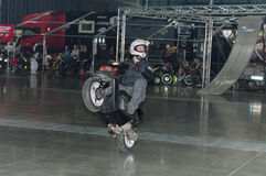 Stuntman riding a scooter during stunt show Royalty Free Stock Photography