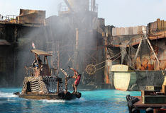 Stuntmans is in action. HOLLYWOOD, CA, USA - SEPTEMBER 17, 2011: Stuntman is in action in the live stunt show called Waterworld on 17 September in 2011 in the Stock Photography