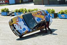 Stuntmans performs a trick on car at the show Stock Image