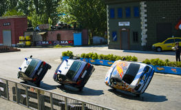 Stuntmans performs a trick on car at the show Royalty Free Stock Photos