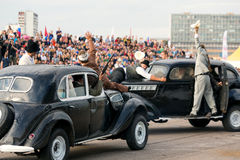 Stuntmen depict a gunfight on old cars. MOSCOW - AUG 25: Stuntmen depict a gunfight on old cars on Festival of art and film stunt Prometheus in Tushino on August stock photo
