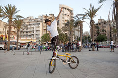 Stunts on a bicycle, Lebanon. A man performing a stunt on a bicycle, Lebanon Stock Photo