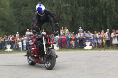 Stunts on a motorcycle by Aleksey Kalinin Stock Images