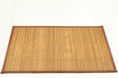 Stuoia di bambù per mangiare Isolato fotografia stock