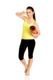 Stuoia pronta di yoga della tenuta della donna di forma fisica Fotografie Stock
