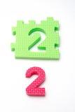 Stuoie di puzzle di numero due. Fuoco sul fronte (piccolo DOF) Fotografia Stock Libera da Diritti