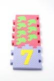 Stuoie di puzzle di numero sette. Fuoco sul fronte (piccolo DOF) Immagine Stock