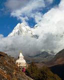 Stupa and Ama Dablam between clouds Royalty Free Stock Images