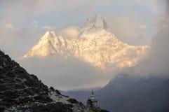 Stupa below great mountain. Buddhist religious Stupa below great white mountain on the trail to Everest Base Camp Stock Photo