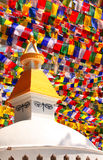 Stupa with Buddha eyes and prayer flags, Kathmandu, Nepal Stock Photos