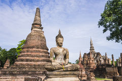Stupa and Buddha Statue in Wat Mahathat Temple, Sukhothai Historical Park, Thailand Stock Photo