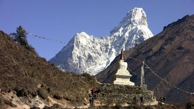 Stupa (buddhism) on the Ama dablam background. stock video footage