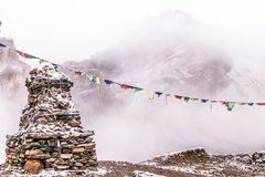 Stupa and buddhist flags. View from the trekking at Annapurnas circuit, Himalaya, Nepal Stock Image