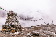 Stupa and buddhist flags. View from the trekking at Annapurnas circuit, Himalaya, Nepal Stock Photography