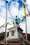 Stupa and buddhist prayer flags Royalty Free Stock Images
