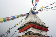 Stupa and buddhist prayer flags Royalty Free Stock Photo