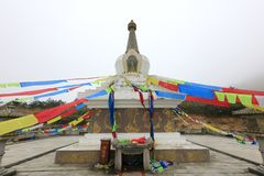 Stupa and buddhist prayer flags. Colourful buddhist prayer flags hanging at jiuxianshan mountain, dehua county, quanzhou city, china royalty free stock photography