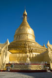 The stupa of Buddhist temple Maha Wizaya Pagoda close up against the background of the blue sky. Yangon, Myanmar Stock Photography