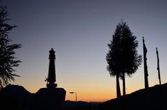 Stupa et coucher du soleil Photo stock