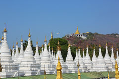 Stupa forest pagoda and Mandalay Hill Royalty Free Stock Photo
