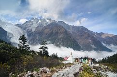 Stupa with Glacier and Mist at Hailuogou National Glacier Forest Park royalty free stock photography