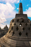 Stupa with hidden Buddha statue BorobudurTemple. Indonesia. Stock Photos