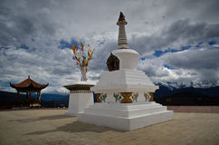 Stupa Infront of Sacred Buddhist Meili Mountain Royalty Free Stock Photography