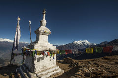 Stupa and the langtang mountain range Royalty Free Stock Photo