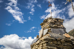 Stupa made of stones in a sunny day. View from the trekking at Annapurnas circuit, Himalaya, Nepal Stock Photo