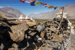 Stupa and player flags near Diskit monastery in Ladakh, Jammu & Kashmir, India Royalty Free Stock Images