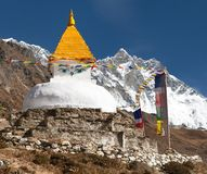 Stupa and prayer flags near Dingboche with mount Lhotse Stock Photos