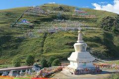 Stupa and prayer flags Stock Photos