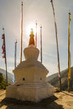 Stupa with prayer flags in sunset Stock Images