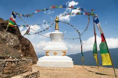 Stupa with prayer flags - way to mount Everest base camp Stock Photo