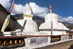 Stupa with prayer flags and wheels Stock Photos