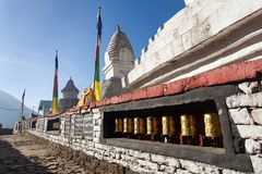 Stupa with prayer flags and wheelsin Stock Photography