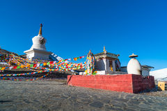 Stupa and prayer flags at the Zheduo Shan Pass Stock Photography