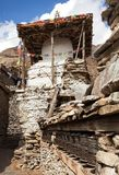 Stupa and prayer wheels wall in Manang villlage Stock Images