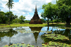 Stupa reflection (Sukhothai, Thailand). A stupa is a mound-likestructure containing typically the remains of Buddhist monks, used as a place of meditation. This Royalty Free Stock Images