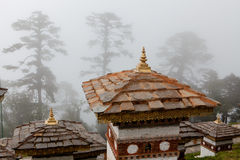 The stupa´s of Dochu La in misty weather Stock Images