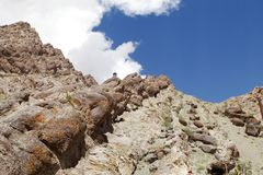 A stupa and Sedimentary rocks near Hemis monastery, Leh Royalty Free Stock Photos